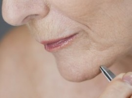 Plucking eyebrows and your chin...magnification shows you all that hair!