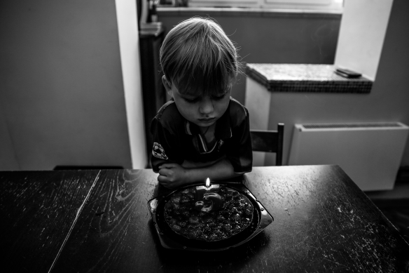 Canva - Boy Looking at Birthday Cake